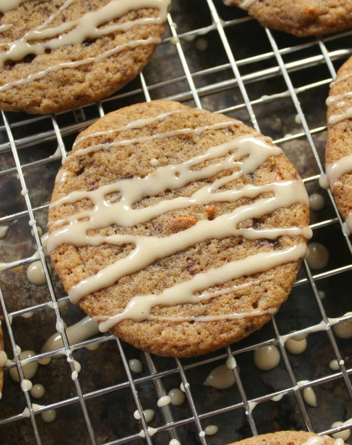 Spiced Pumpkin Latte Cookies on a cooling rack with Coffee Glaze on top of them.