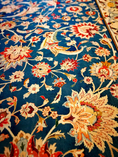 The Sultan Qaboos Grand Mosque in Muscat Oman - tapestry carpet close up