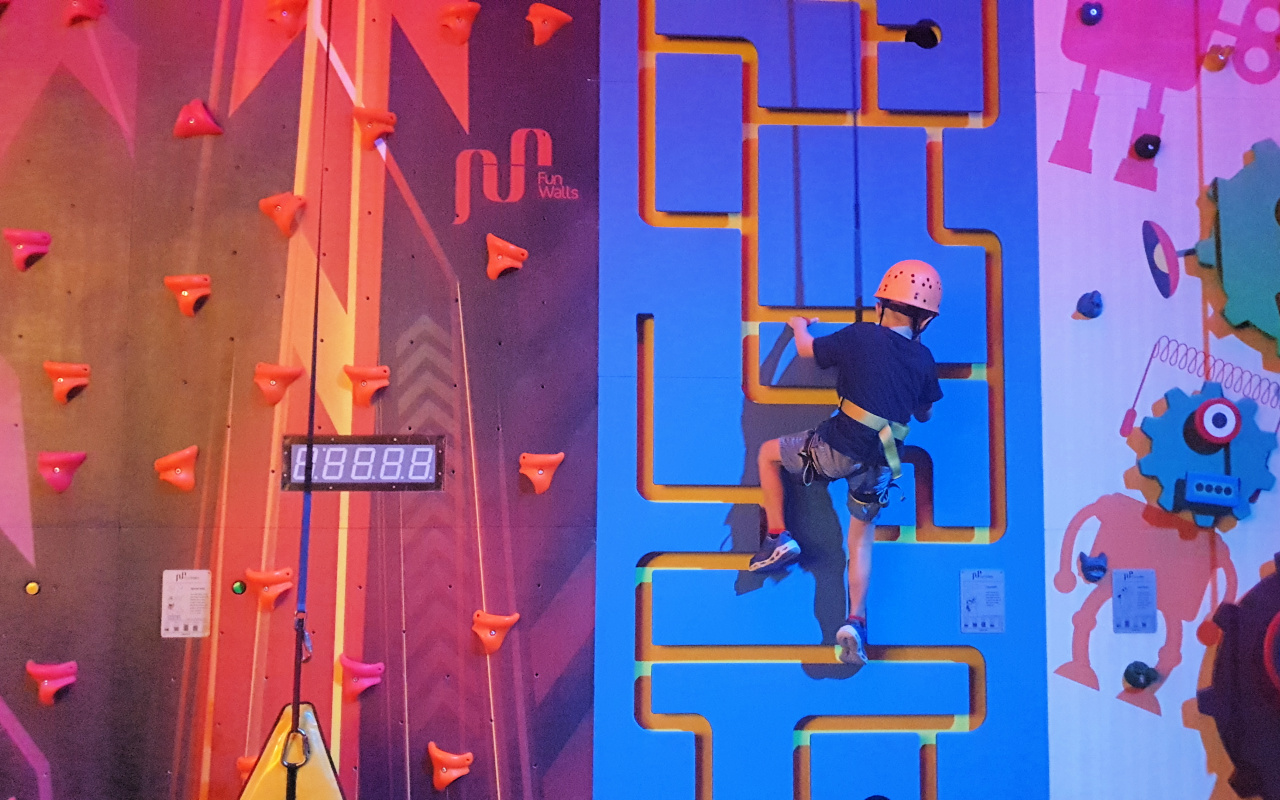 Child on the climbing wall of Xtreme Zone