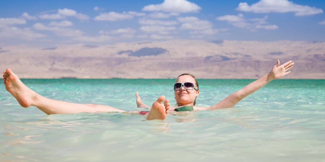Lady floating in the Dead Sea - Jordan 5 Day itinerary