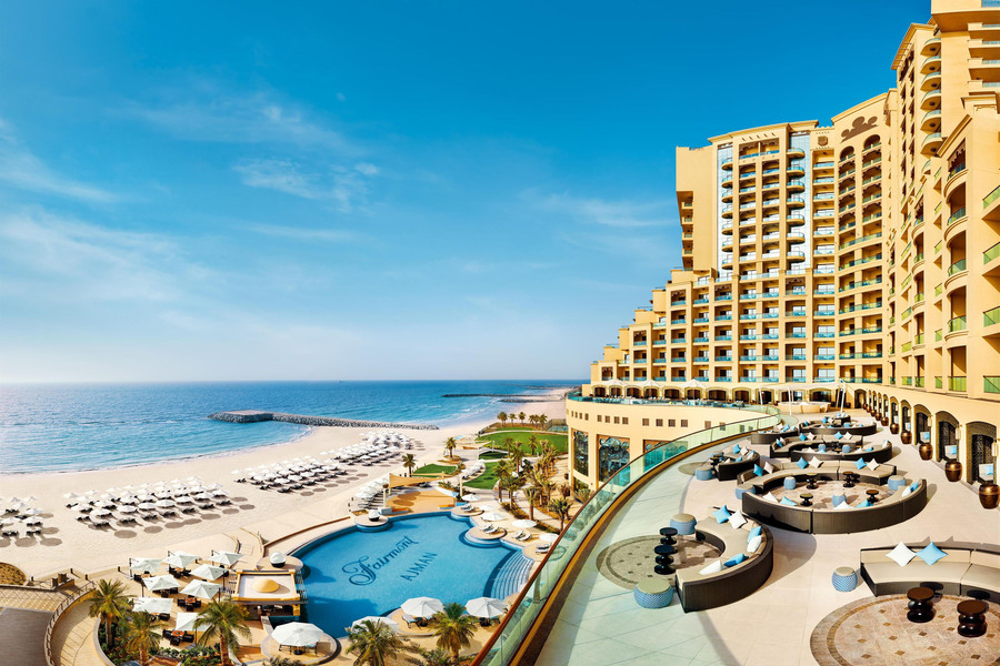 Dairmont Ajman Hotel building and pool