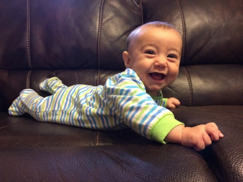 Baby Cale Smiling on the couch