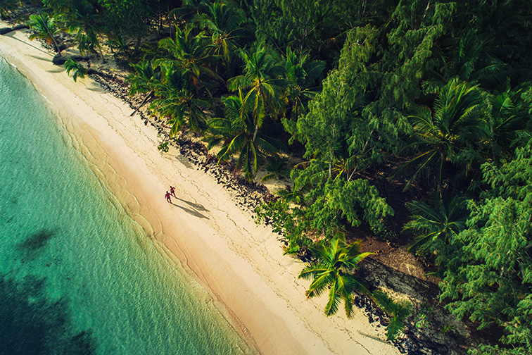 Aerial view of tropical island beach, Dominican Republic; Courtesy of Valentin Valkov/Shutterstock