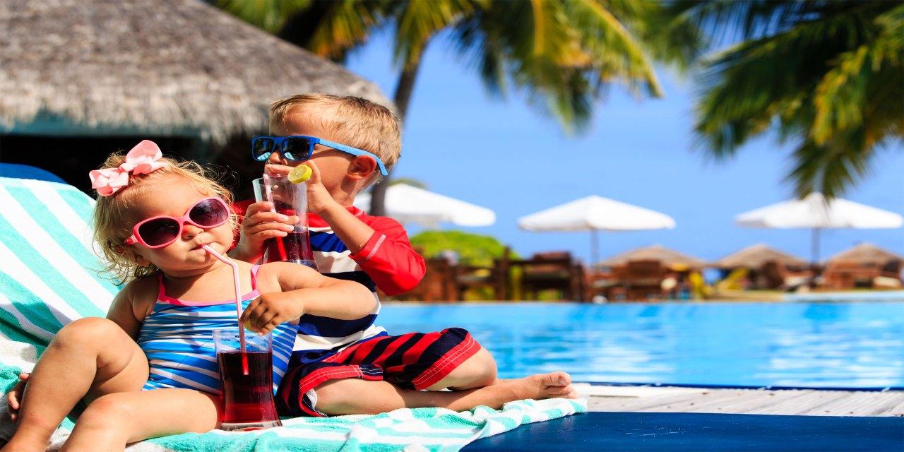 Toddlers At Resort; Courtesy of Nadya Eugene/shutterstock.com
