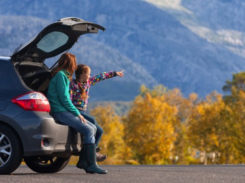 Mother and Daughter in SUV in Mountains; Courtesy of Mostovyi Sergii Igorevich/Shutterstock.com