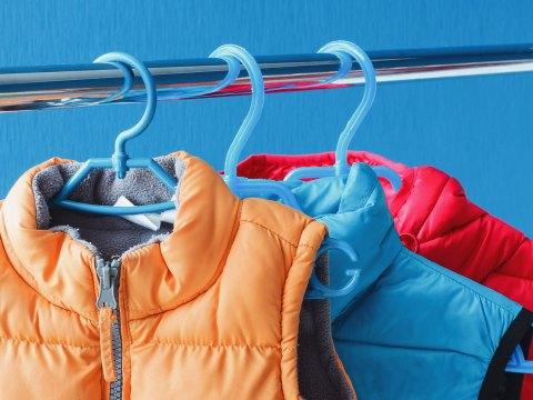 Winter Vests Hanging in a Closet; Courtesy of PicMy/Shutterstock