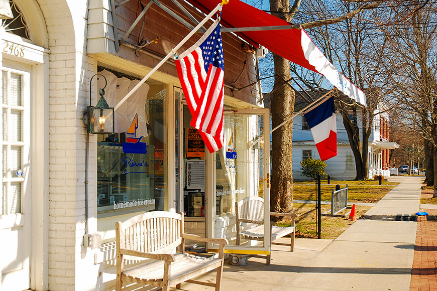 a French cafe flies the tri-colors in East Hampton, New York; Courtesy of James Kirkikis/Shutterstock
