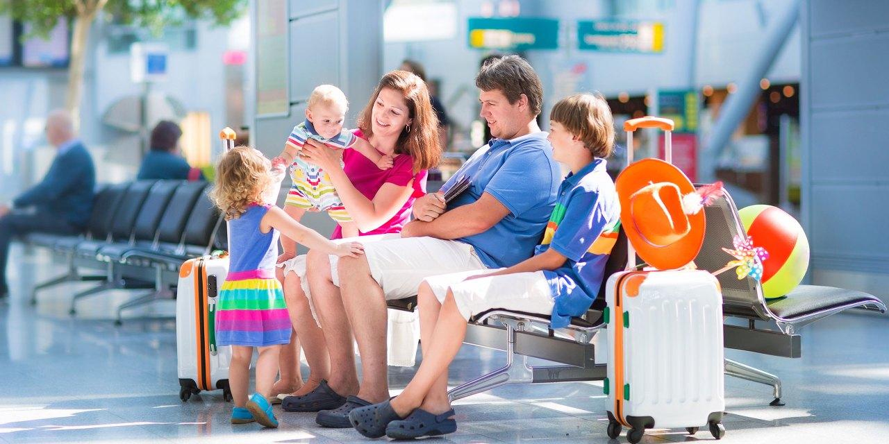 Family at Airport; Courtesy of FamVeld/Shutterstock.com