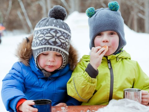 Little Boys Sipping Hot Cocoa; Courtesy of mamaza/Shutterstock.com