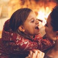 Mom and Daughter in Cozy Cabin; Courtesy ofAlena Ozerova/Shutterstock.com