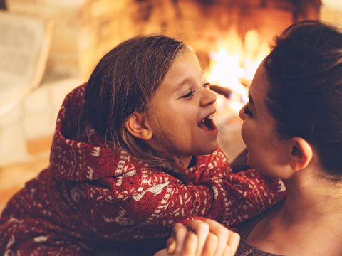 Mom and Daughter in Cozy Cabin; Courtesy ofAlena Ozerova/Shutterstock.com