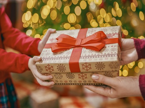 giving gift holiday chritsmas tree; Courtesy of Yuganov Konstantin/Shutterstock