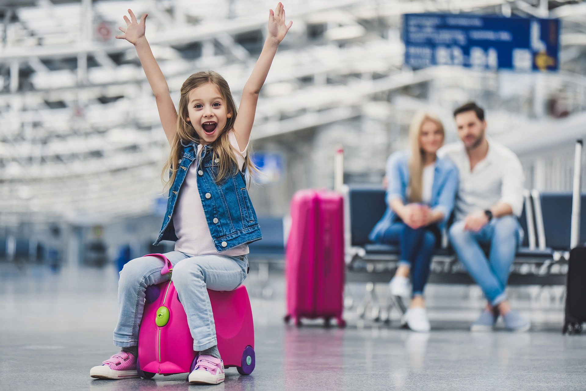Girl Happy At The Airport; Courtesy of 4PM production/Shutterstock.com