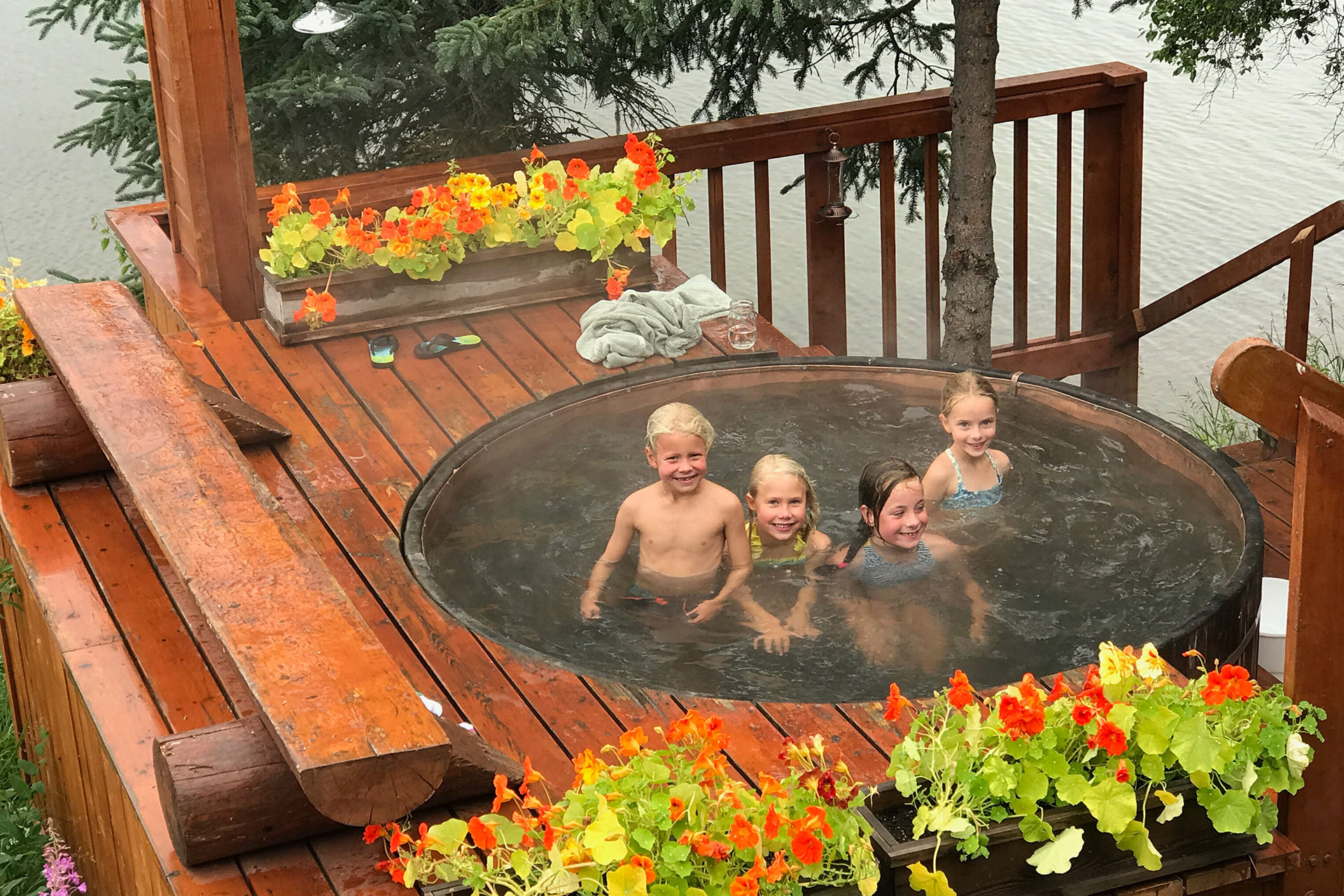 Kids in Hot Tub at Tordrillo Mountain Lodge; Courtesy of Tordrillo Mountain Lodge