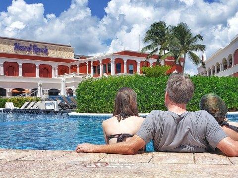 Dad and Daughers at Hard Rock Hotel in Riviera Maya; Courtesy of Jeff Bogle
