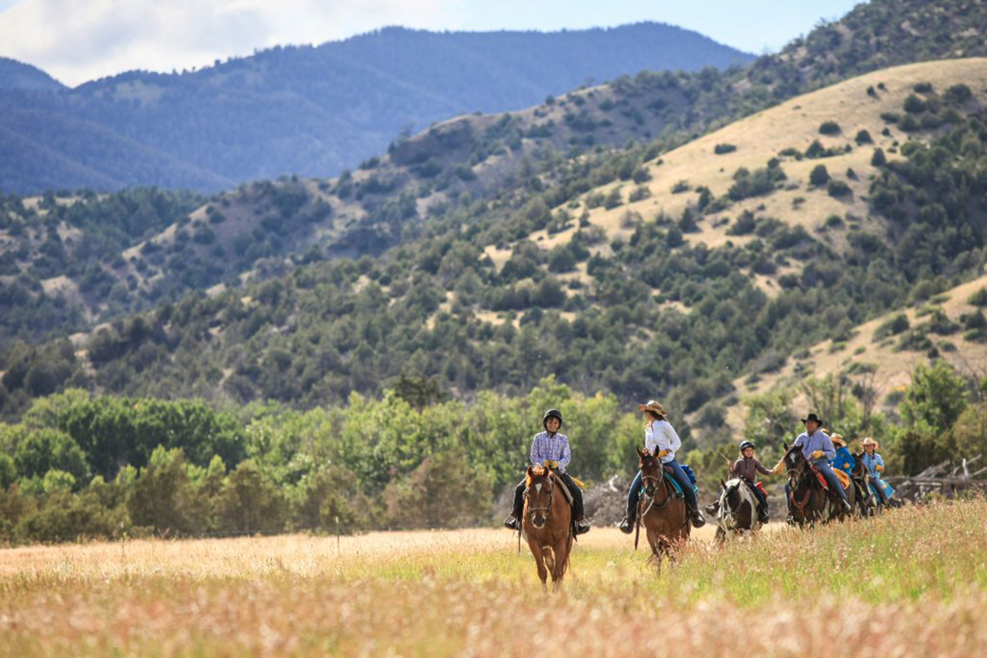 Family Horseback Riding at Mountain Sky Guest Ranch in Emigrant, Montana; Courtesy of Mountain Sky Guest Ranch