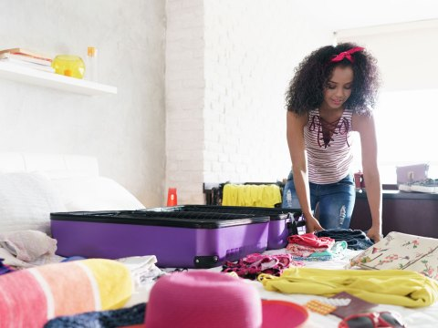 Woman Packing Suitcase; Courtesy of Diego Cervo/Shutterstock.com