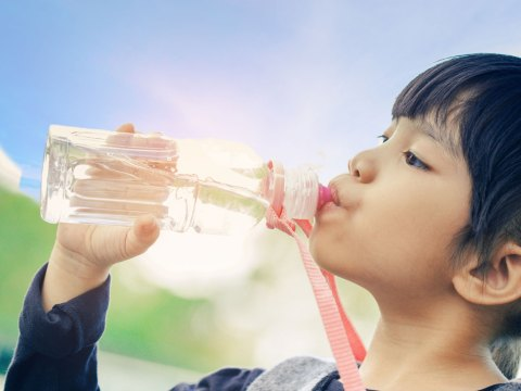 Girl Drinking Water Bottle; Courtesy of Casezy idea/Shutterstock.com