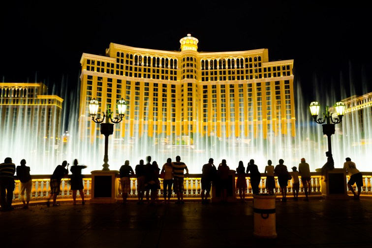 People watch the musical fountains at Bellagio Hotel & Casino in Las Vegas.