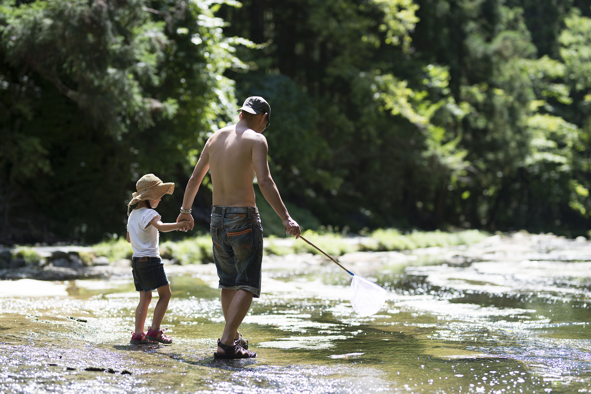 Dad and Daughter Playing in River; Courtesy of Purino/Shutterstock.com
