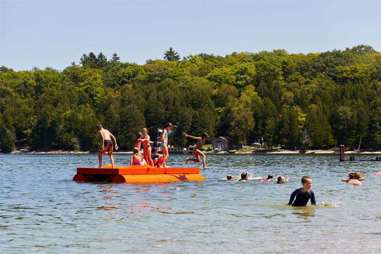 Kids at Schoolhouse Beach in Wisconsin; Courtesy of Door County Visitor Bureau