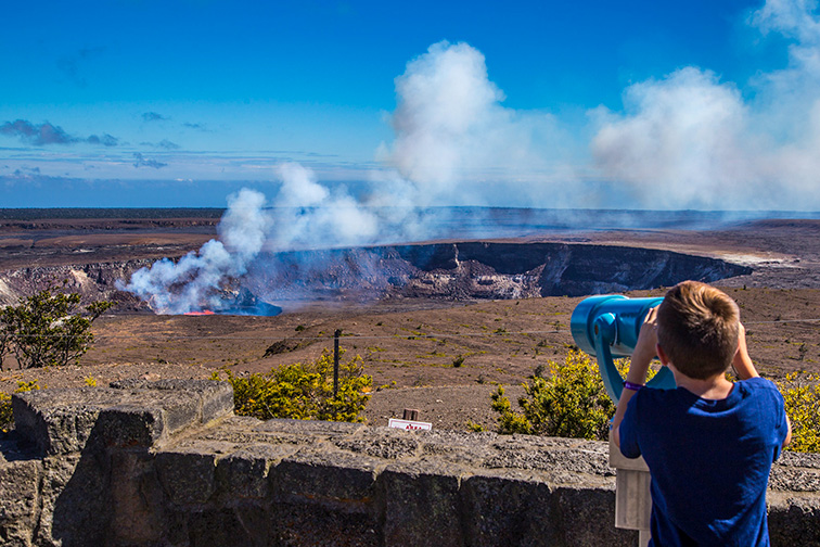 Young visitor checks out lava lake Hawaii Volcanoes National Park; Courtesy NPS