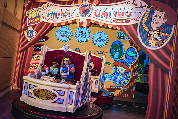 Walt Disney World Resort guests take aim and score big playing the virtual midway games of Toy Story Mania!; Courtesy of Walt Disney World