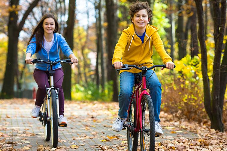 teens and bikes in city park ; Courtesy of Jacek Chabraszewski/Shutterstock
