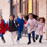kids running wearing coats; Courtesy of Monkey Business Images /Shutterstock