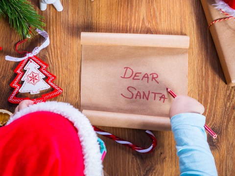 Top view of child writing letter to Santa Claus for Christmas ; Courtesy of Patryk Kosmider /Shutterstock