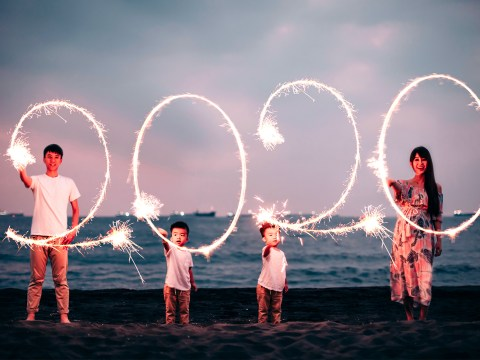 asian family celebrates new years 2020 sparklers; Courtesy of Tom Wang/Shutterstock