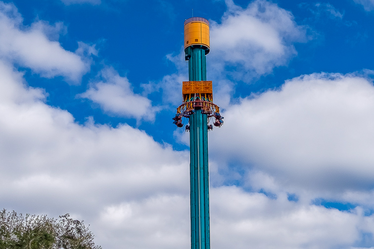 Falcon's Fury Drop Tower in Busch Gardens on a cloudy day with blue sky in the background. The ride has reached the top of the 300 ft tower and has inverted in. ; Courtesy  Dolores M. Harvey/Shutterstock