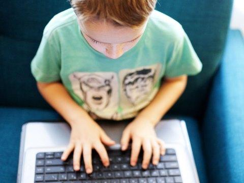 Boy playing on laptop; Courtesy of Twenty20