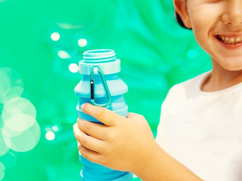 boy holding que water bottle