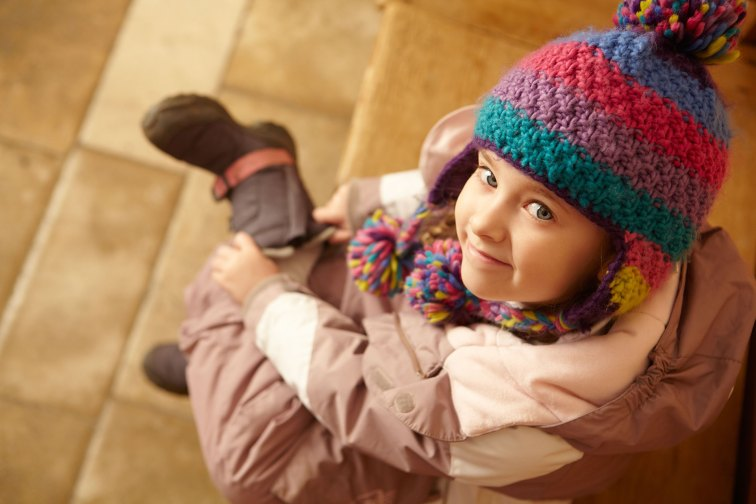 A little girl getting ready to hit the slopes.; Courtesy of Monkey Business Images/Shutterstock.com