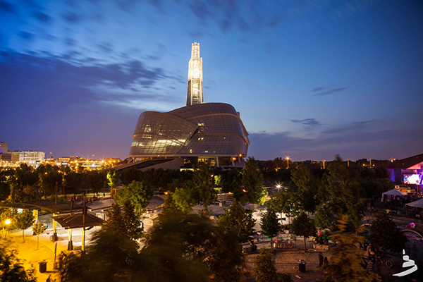 Canadian Museum of Human Rights lit up at night.