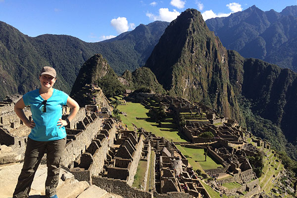 Judy Koutsky standing over Machu Picchu in Peru.