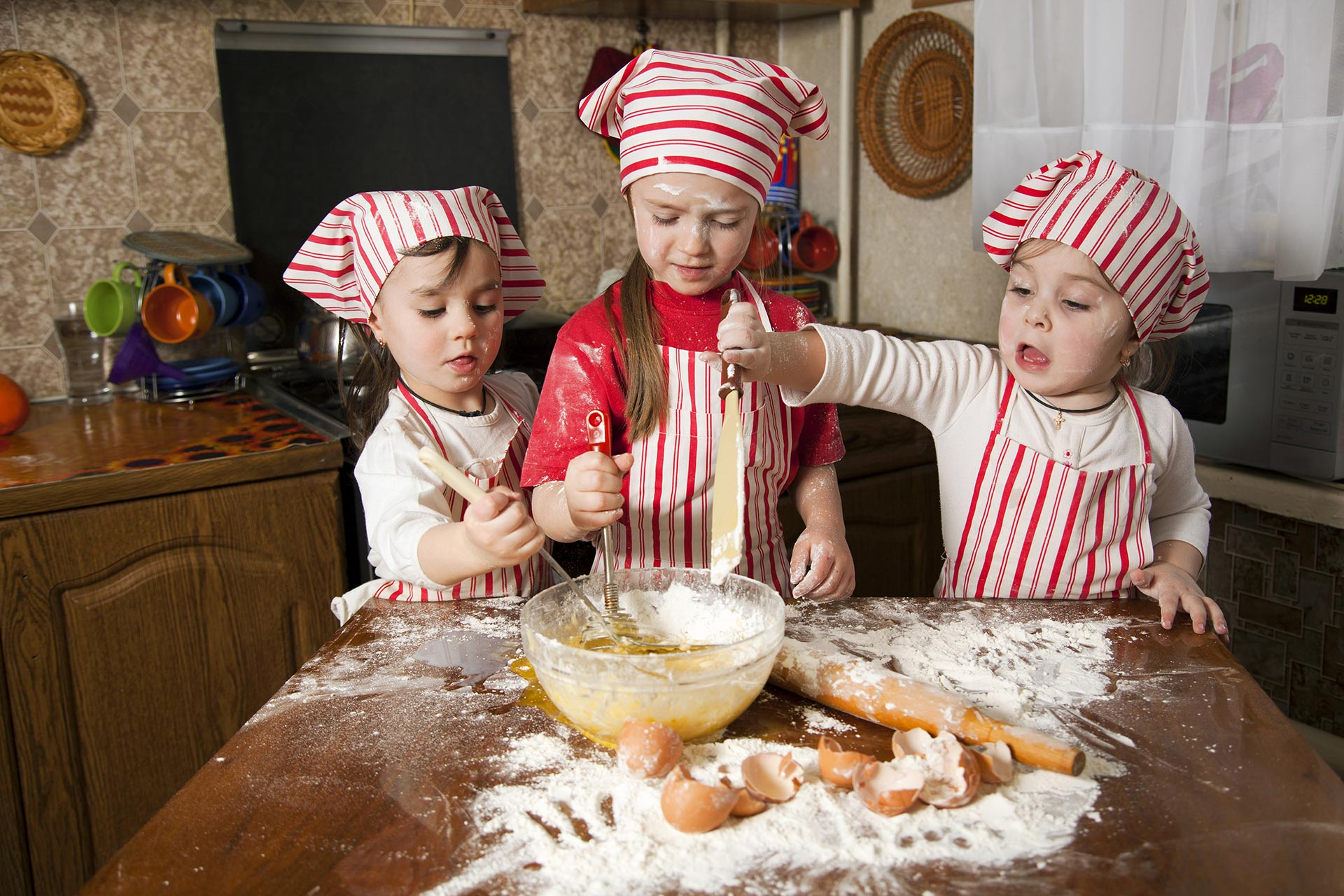 Sisters making bread together.