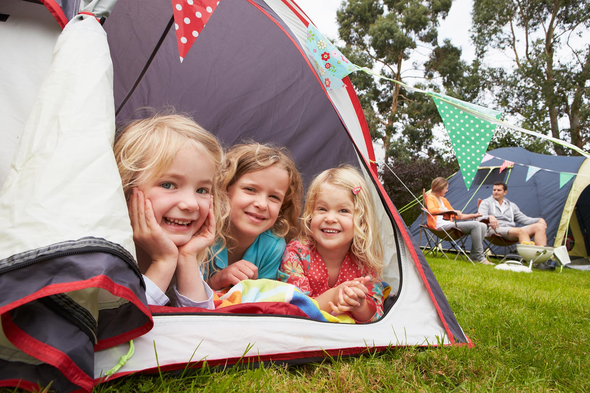 A family enjoying a camping trip together.