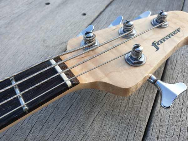 PeeWee electric bass ukulele headstock
