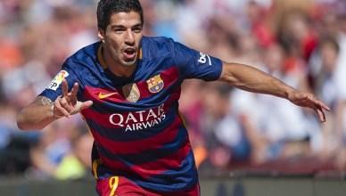 Suarez inspires Barca to win at Granada