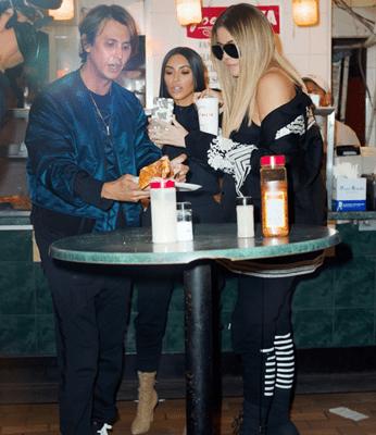 Kim Kardashian Grabbig Some Pizza Along Side Khloe Kardashian