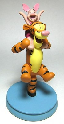 Piglet sitting on Tiggers shoulders figure from our Other
