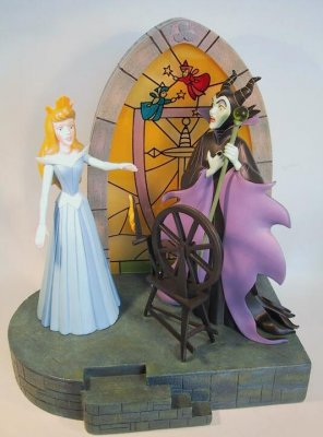 Sleeping Beauty At The Spindle And Maleficent Figure From
