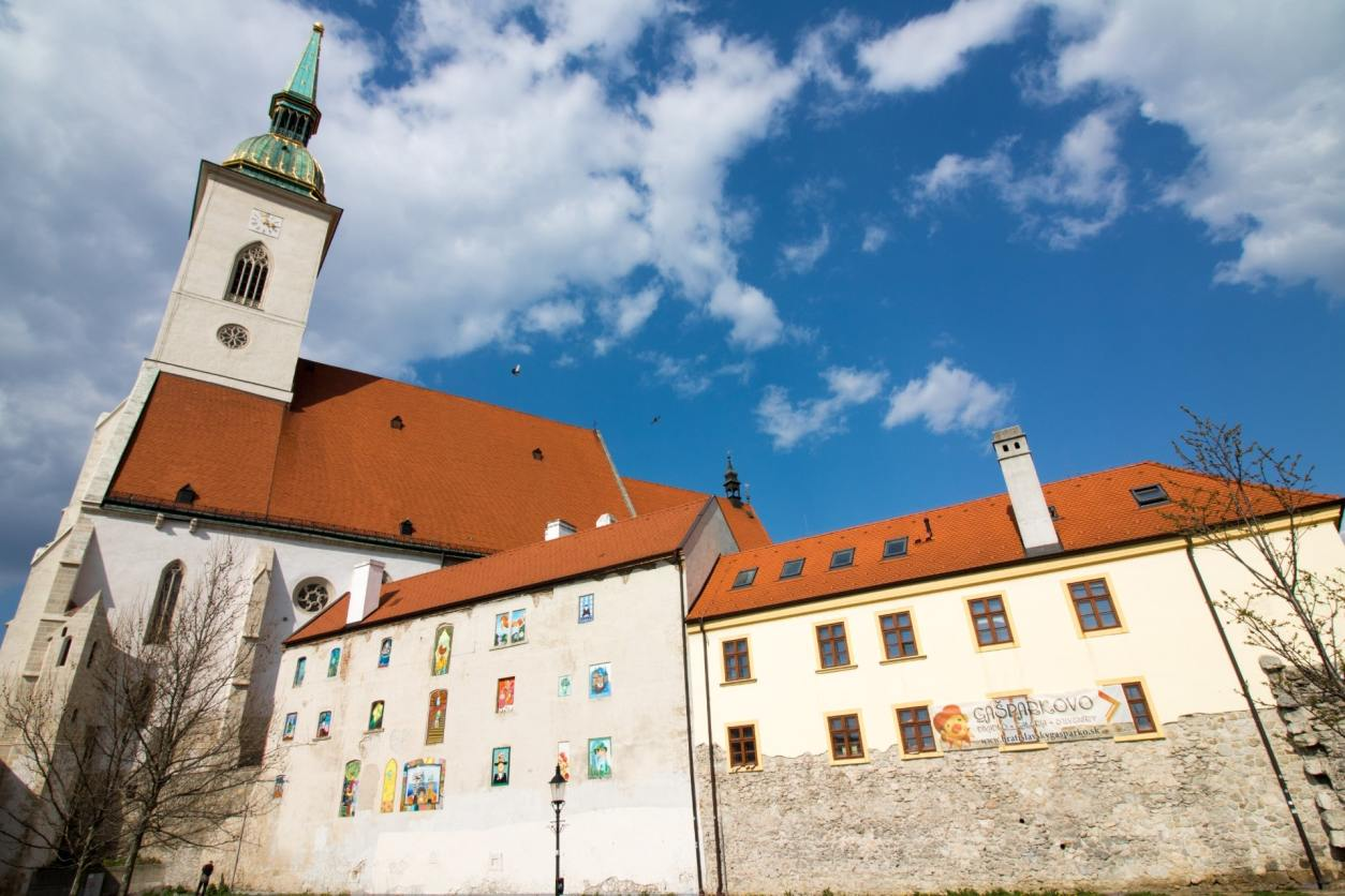 gorgeous-european-cathedral-with-stained-glass-windows-and-an-orange-roof-on-a-sunny-summers-day-one-day-in-bratislava-st-martins-cathedral