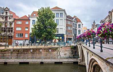 bridge-crossing-a-bike-lined-river-in-a-cute-european-city-with-colourful-houses-dylepath-reasons-to-visit-mechelen-belgium