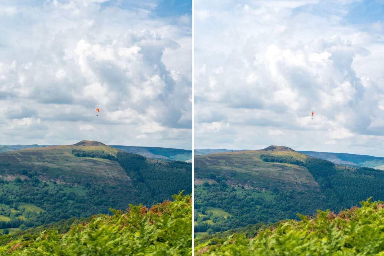 paraglider-flying-over-lush-green-hills