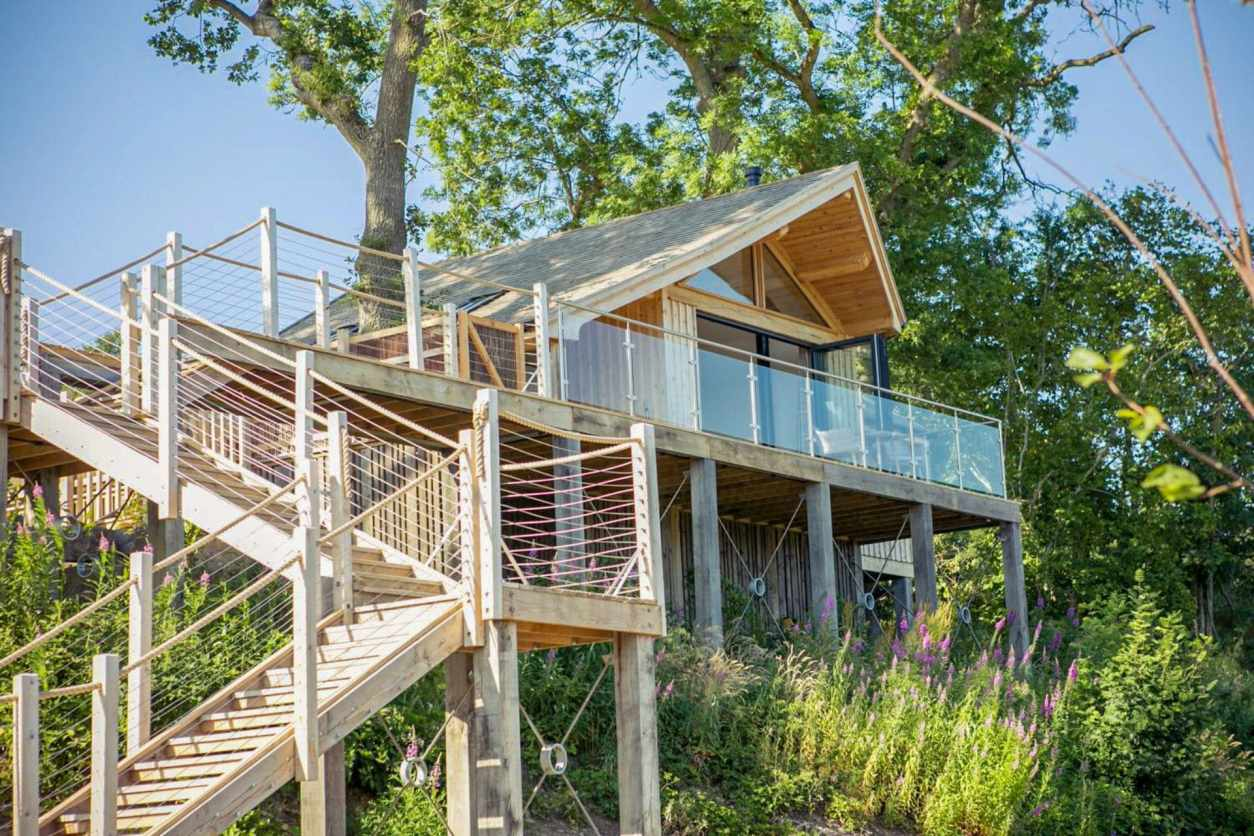 steps-leading-up-to-beach-inspired-treehouse-found-amongst-trees-oaklands-treehouse-welshpool-powys-wales