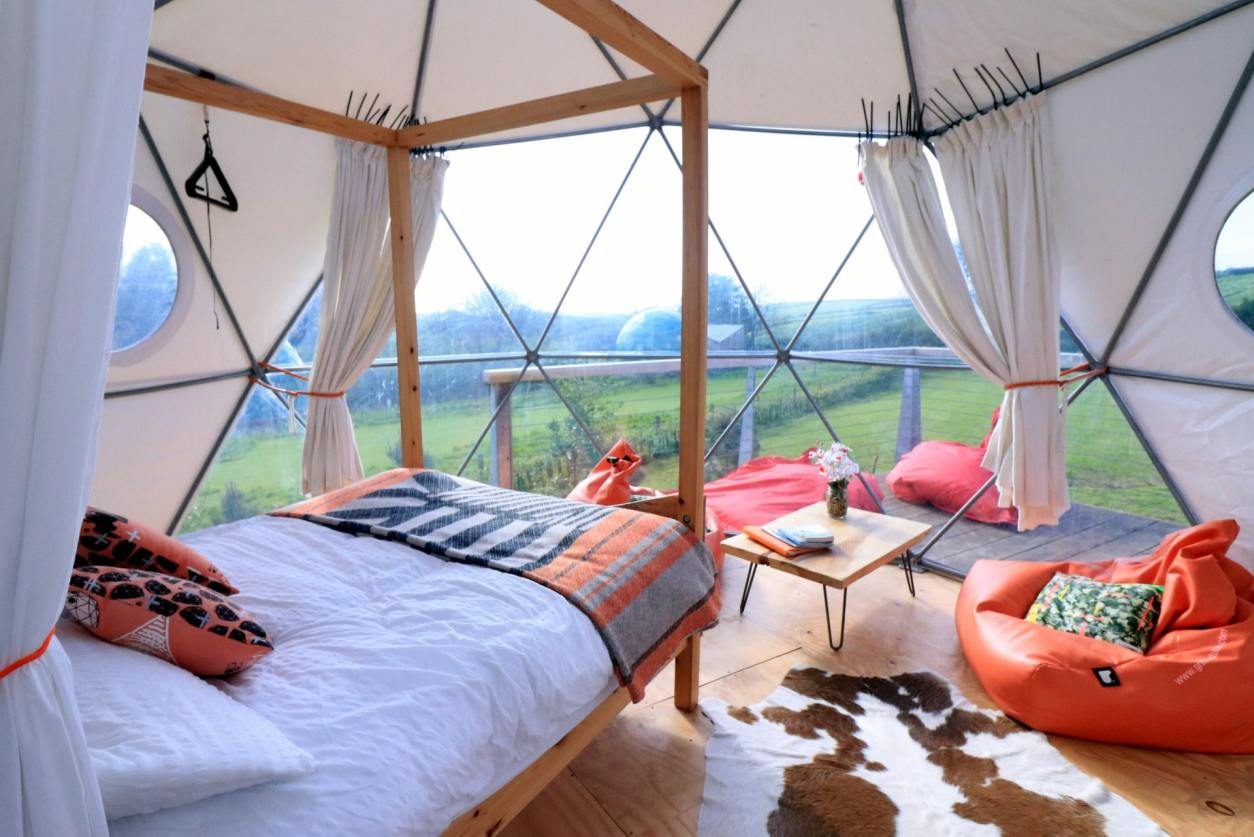inside-a-quirky-geodome-glamping-site-in-a-field-with-a-four-poster-bed-loveland-farm-devon-unusual-romantic-weekend-breaks-uk