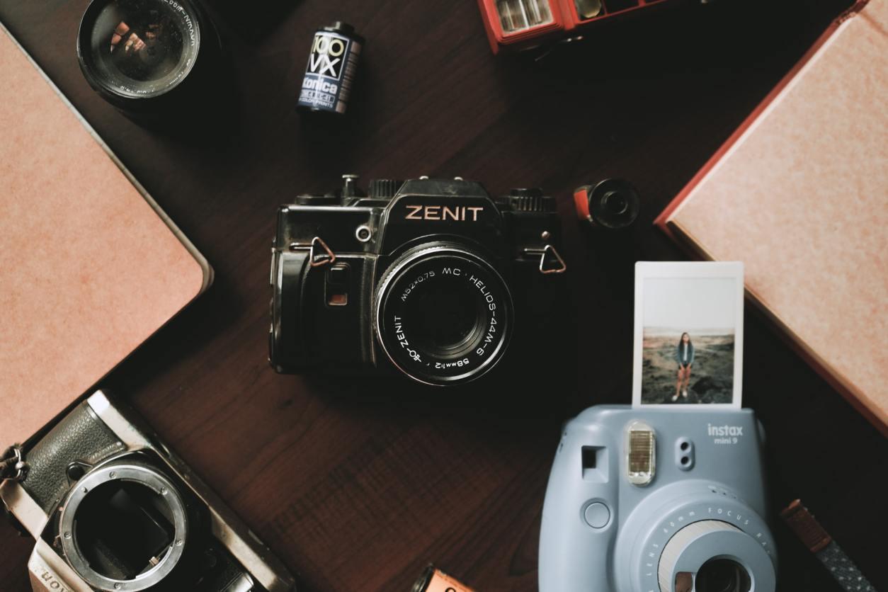 film-cameras-and-polaroid-camera-on-table-photography-ski-season-packing-list